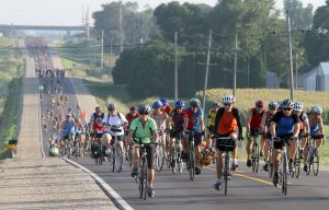 m0730ragbrai - shot 07/29/10 along RAGBRAI, IA. Christopher Gannon/The Register -- RAGBRAI Thursday -- Riders make their way out of Charles City Thursday morning on RAGBRAI. (Christopher Gannon/The Des Moines Register)